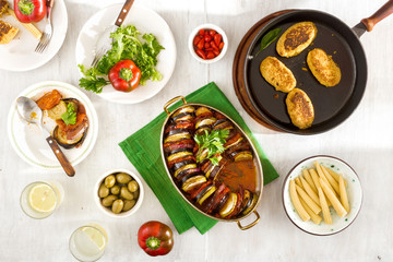 Ratatouille, chickpeas cutlets, lemonade and various snacks, top view