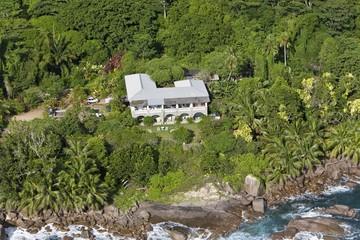 A luxury villa on the coast at Grand Anse beach, Island of Mahe, Seychelles, Indian Ocean, Africa