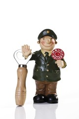 Miniature figure of a police man with a bottle opener