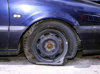 Flat tyre on a car involved in an accident