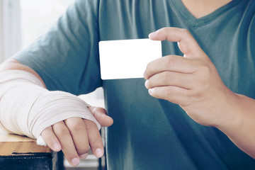 Broken Hand Man Holding Electronic Card Use for Accident Insurance, Shopping and Hospital Treatment fee