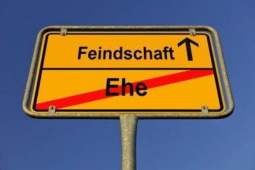 City limits sign with the words Feindschaft and Ehe, German for hostility and marriage, symbolic image for the end of marriage leading to hostility