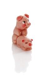 Two marzipan pigs, humorous symbolic image pairing