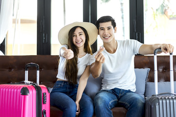Happiness Asian couple traveler packing suitcases preparing for travel vacation together.Happy enjoy to smiling at home in the living room.Travel concept .