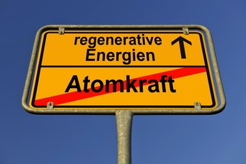 Symbolic image in the form of a town sign, in German, exit from atomic power, entrance into regenerative energy sources