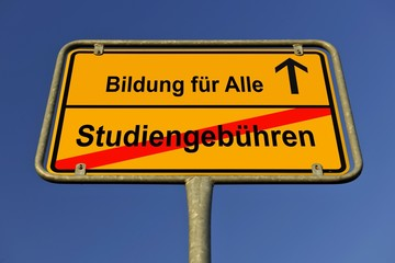 City limits sign with the words Bildung fuer Alle and Studiengebuehren, German for education for everybody and tuition fees, symbolic image for the abolition of tuition fees to enable the right to education for all