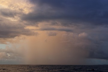 Storm, rain shower and thunderstorm over the sea