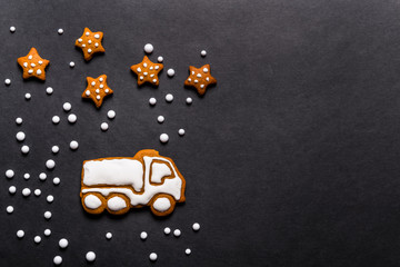 Gingerbread cookies truck shaped on black background, Christmas concept
