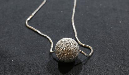 elegant aluminum pendant worked with very brilliant facets of ne