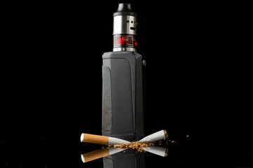 Tobacco cigarette crushed under electronic cigarette