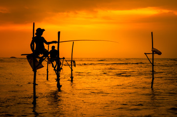 Silhouettes of the traditional fishermen
