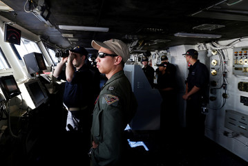 Crew members are seen on duty on USS Ronald Reagan in South China Sea