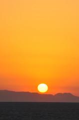 Sunrise on salt lake in the Sahara desert, Tunisia