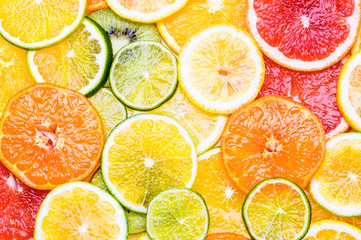 Fresh citrus fruits sliced assortment top view flat lay background. Vitamin c fruits, fruit acid.