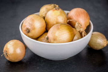 White Onions on a slate slab, selective focus