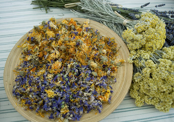 detail of spontaneous flowers (mallow, helicris, marigold, lavender), whose flowers are hand-picked and then dried to maintain the healing properties used in the fall like herbal teas, italy