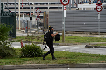 A Spanish national police officer walks outside the port where hundreds of Spanish national police and civil guard reinforcements are housed in two ferries a day before the banned October 1 independence referendum, in Barcelona