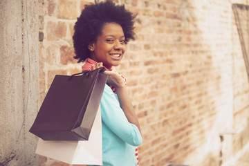 Happy african american girl with shopping bags