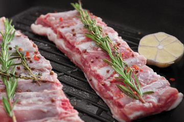 Grill pan with fresh raw ribs, closeup