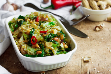 Fried savoy cabbage with peanuts and chili