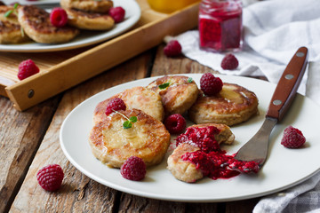 cheese pancakes with raspberry sauce