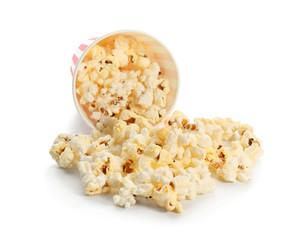 Paper cup and popcorn on white background