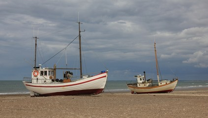Two fishing boats on a cloudy summer day. Summer scene at Thorup beach, Denmark.