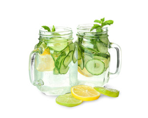Fresh cucumber water with lemon and mint in mason jars, isolated on white