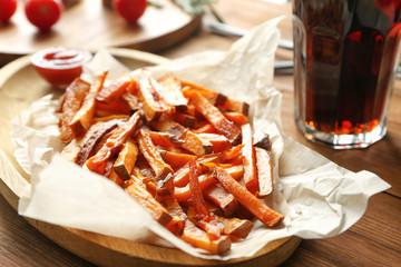 Sweet potato fries on table