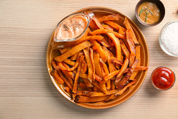 Sweet potato fries on table
