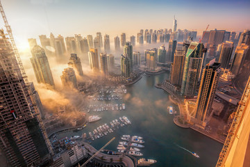 Dubai Marina with colorful sunset in Dubai, United Arab Emirates