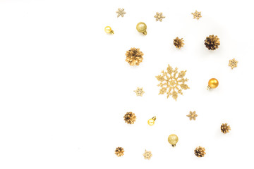 Golden christmas decorations on white background. Flat lay, top view. Christmas card.