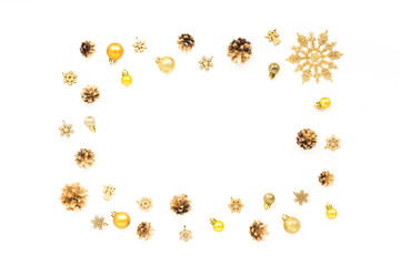 Frame made of golden christmas decorations on white background. Flat lay, top view. Christmas card.