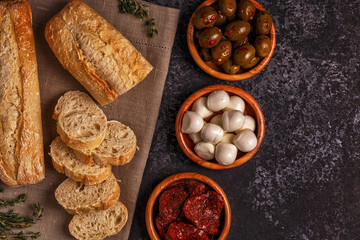 Fresh bread with snacks.