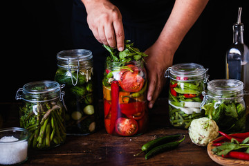 Canning tomatoes pickled Preserving tomatoes  add aromatic herbs
