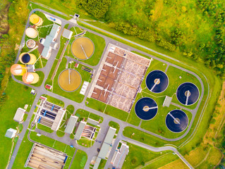 Aerial view to sewage treatment plant in green fields. Grey water recycling. Waste management for 165, 000 inhabitants of Pilsen city in Czech Republic, Europe.