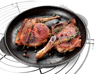 Frying pan with grilled meat on white background