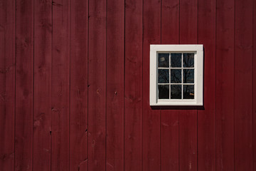 Red barn with white window
