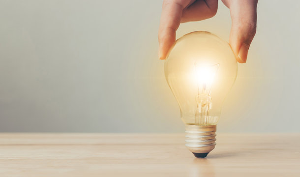 Hand holding light bulbs, Concept new ideas for your business or thinking creativity, Copy space