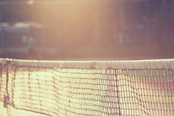 Tennis net with bokeh nature in the background