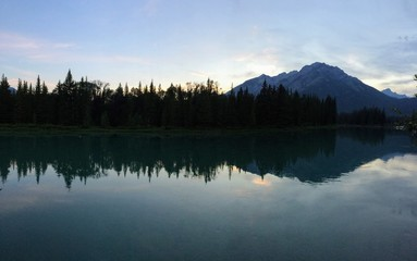 Foto op Canvas Ochtendstond met mist Banff, Bow River, evening reflection with mountain in background
