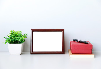 Workspace mock up picture frame on desk In modern office