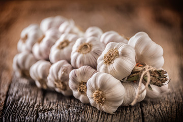 Garlic. Garlic bulbs. Fresh garlic on rustic oak table.