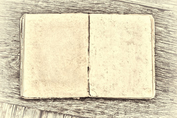 An old book on a wooden table. Country style