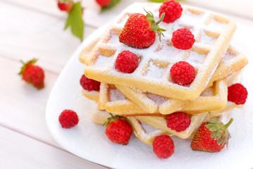 Belgian waffles with strawberries and raspberries.