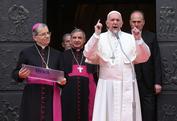 Pope Francis gestures as he talks during a pastoral visit in Cesena