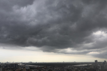 black clouds with thunder storm on the sky before rain