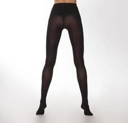 Tall model posing in black classic stockings
