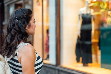 Woman looking at boutique showcase