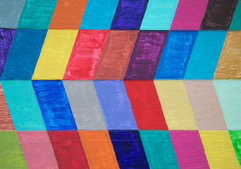 Multicolored chevron pattern on wood background